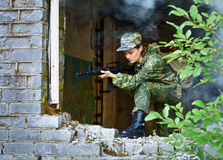 Woman with a rifle, keep defense in the battle Stock Image