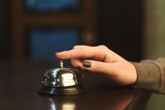Woman ringing hotel reception service bell closeup Stock Photography