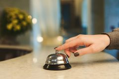 Woman ringing hotel reception service bell closeup Royalty Free Stock Photo