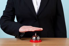Woman ringing a reception bell Royalty Free Stock Photography