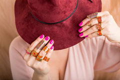 Woman with rings holding hat Royalty Free Stock Photo