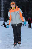Woman on the rink in the evening Royalty Free Stock Photo