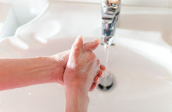 Woman rinsing her hands Royalty Free Stock Images