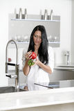 Woman rinsing peppers in a sink Royalty Free Stock Photography