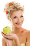Woman with ripe green apple Stock Image