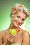 Woman with ripe green apple Royalty Free Stock Photography
