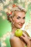 Woman with ripe green apple Stock Photo