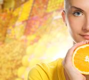 Woman with ripe orange Royalty Free Stock Photos