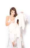 Woman in ripped wedding dress on white background Royalty Free Stock Photos