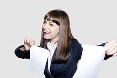 Woman ripping paper Royalty Free Stock Photo