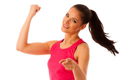 Woman rises arm as gesture of power and success  over wh Royalty Free Stock Images