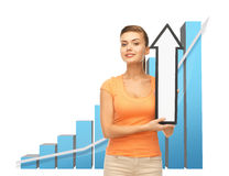 Woman with rising graph and arrow directing up Royalty Free Stock Image