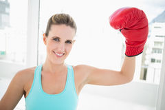 Woman rising her boxing glove up Stock Photography