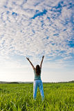 Woman rising up hands Stock Image
