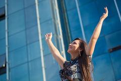 Woman rising up hands Royalty Free Stock Image