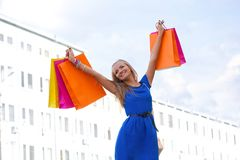 Woman rising up shopping bags Royalty Free Stock Photo