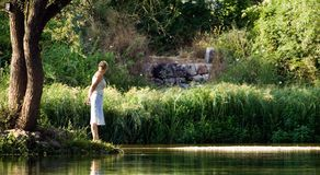 Woman by the river. Woman enjoy by the river royalty free stock photo