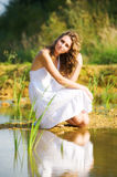 Woman on a river bank Stock Photo