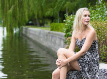 Woman by the river Stock Image