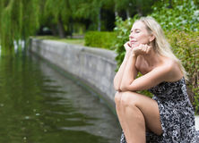 Woman by the river Royalty Free Stock Photo