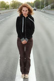 Woman on the road. Beautiful young woman on the road royalty free stock photo