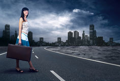 Woman on the road Stock Photography