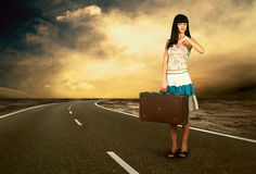 Woman on the road Stock Image