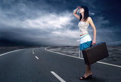 Woman on the road Royalty Free Stock Image