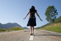 Woman on the road. Only going Royalty Free Stock Images