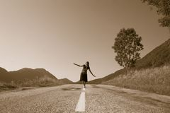 Woman on the road Stock Photo