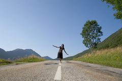 Woman on the road. Only going Stock Photos
