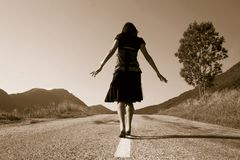 Woman on the road. Only going Royalty Free Stock Image