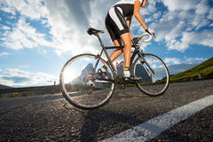 Woman road cycling tour. A girl take a round trip with her bicycle Royalty Free Stock Photo