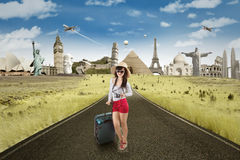 Woman on the road with famous landmarks background Stock Image