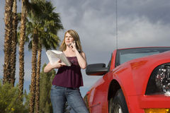 Woman With Road Map On Call Royalty Free Stock Photography