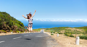 Woman on the road in mountains Royalty Free Stock Images