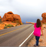 Woman at the road in Valley of Fire State Park Royalty Free Stock Image
