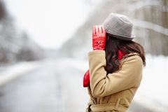 Woman on a road in the winter Royalty Free Stock Image