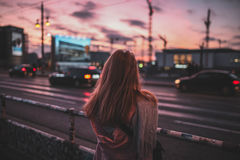 Woman on roadside at sunset