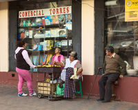 Woman Roasting Plantains on Street in Banos, Ecuador Royalty Free Stock Photo