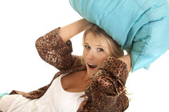 Woman in robe blue pillow over head Stock Image