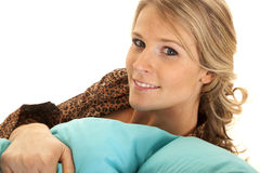 Woman robe with blue pillow smile Royalty Free Stock Photo