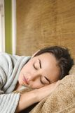Woman in robe sleeping. Royalty Free Stock Image