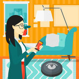 Woman with robot vacuum cleaner. Stock Images
