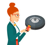 Woman with robot vacuum cleaner Stock Images