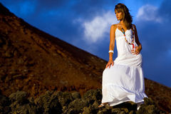 Woman on a rock Royalty Free Stock Photos