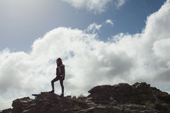Woman on rock admiring the view after a hike Royalty Free Stock Photos