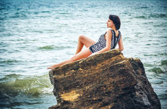 Woman on rock in beach Royalty Free Stock Photography