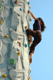 Woman Rock Climber in Action. Woman rockclimbing in bare feet Stock Photo
