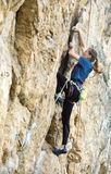 Woman rock climber on the cliff Royalty Free Stock Photos